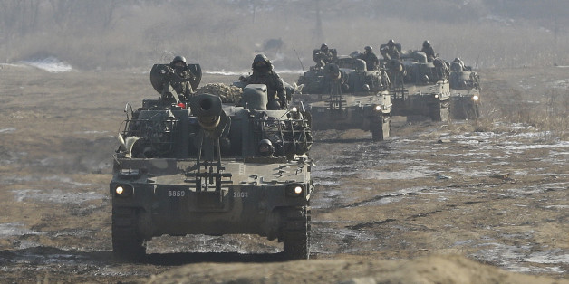 South Korean army K-55 self-propelled artillery vehicles move during a military exercise near the demilitarized zone between the two Koreas in Paju, South Korea, Sunday, Jan. 11, 2015. North Korea has told the United States that it is willing to impose a temporary moratorium on its nuclear tests if Washington scraps planned military drills with South Korea this year, the North's official news agency said Saturday. (AP Photo/Ahn Young-joon)