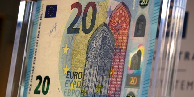 The new 20 EURO note is presented by the President of the European Central Bank, ECB in Frankfurt am Main, central Germany, on February 24, 2015. AFP PHOTO / DANIEL ROLAND        (Photo credit should read DANIEL ROLAND/AFP/Getty Images)