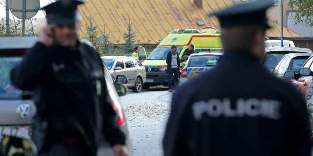 ZDAR NAD SAZAVOU, CZECH REPUBLIC - OCTOBER 14:  Police officers stand in front of a Czech high school after a woman stabbed students with a knife on October 14, 2014 in Zdar nad Sazavou, 160 km (100 miles) southeast of Prague, Czech Republic. A 26-year-old woman killed a 16-year old boy and injured a police officer and two other 17-year old female students during the knife attack at the school. (Photo by Libor Plihal/isifa/Getty Images)