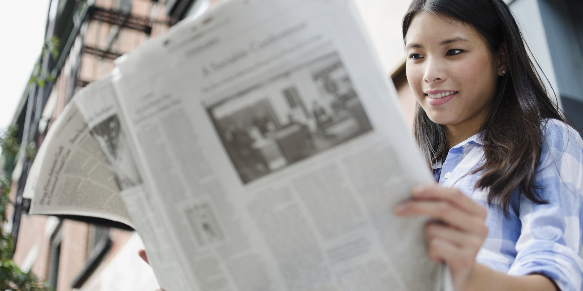 Resultado de imagem para student reading newspaper
