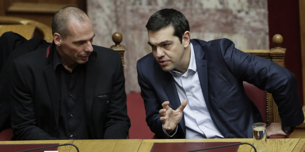 Greece's Prime Minister Alexis Tsipras, right, and Finance Minister Yanis Varoufakis talk during a Presidential vote in Athens, on Wednesday, Feb. 18, 2015. Greece's parliament elected a conservative law professor and veteran politician Wednesday as the country's new president, after he received support from the new left-wing government and main center-right opposition party. (AP Photo/Petros Giannakouris)