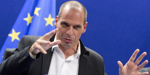 Greek Finance Minister Yanis Varoufakis speaks during a media conference after a meeting of eurogroup finance ministers in Brussels on Friday, Feb. 20, 2015. Eurozone finance ministers meet for a crucial day of talks Friday to see whether a Greek debt relief proposal is acceptable to Germany and other nations using the common currency. (AP Photo/Virginia Mayo)