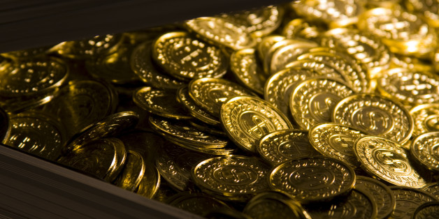 Gold coins in a metal case.