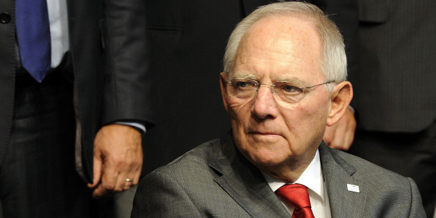 German Finance Minister Wolfgang Schauble attends a meeting in Milan, Italy, Saturday, Sept. 13, 2014. European finance ministers are discussing proposals for leveraging private investments to relaunch the continent's moribund economy. European ministers are holding their first meeting since European Central Bank chief Mario Draghi outlined a three-pillared strategy to save the eurozone economy. Saturday's session was focusing on a proposal for 300 billion euros ($388 billion) in investments to revive the economy. (AP Photo/Giuseppe Aresu)
