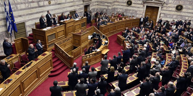 Greek lawmakers applaud at the end of the vote for a president at the Greek parliament in Athens, on February 18, 2015.  Greece's parliament on Wednesday elected pro-European conservative Prokopis Pavlopoulos as the country's new president, a move calculated to bolster the hard-left government in its critical EU bailout talks.  AFP PHOTO / LOUISA GOULIAMAKI        (Photo credit should read LOUISA GOULIAMAKI/AFP/Getty Images)