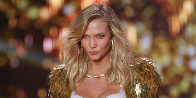 Model Karlie Kloss displays a creation at the Victoria's Secret fashion show in London, Tuesday, Dec. 2, 2014. (Photo by Joel Ryan/Invision/AP)