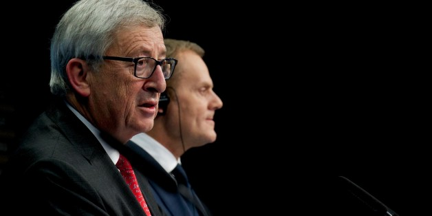 BRUSSELS, BELGIUM - FEBRUARY 12: European Commission President Jean-Claude Juncker (L) and European Council President Donald Tusk (R) hold a press conference after the European Union Leaders Summit at the European Council headquarters in Brussels, Belgium, on February 12, 2015. (Photo by Dursun Aydemir/Anadolu Agency/Getty Images)