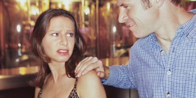 man approaching a woman in a bar
