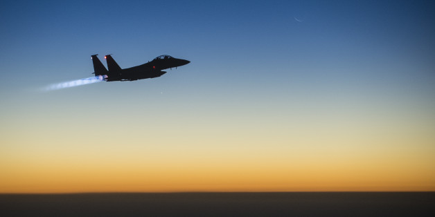 In this Tuesday, Sept. 23, 2014 photo, released by the U.S. Air Force, a U.S. F-15E Strike Eagle flies over northern Iraq, after conducting airstrikes in Syria. U.S.-led coalition warplanes bombed oil installations and other facilities in territory controlled by Islamic State militants in eastern Syria on Friday, Sept. 26, 2014, taking aim for a second consecutive day at a key source of financing that has swelled the extremist group's coffers, activists said. (AP Photo/U.S. Air Force, Matthew Br