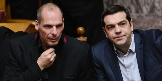 Greek Prime Minister Alexis Tsipras (R) and Finance Minister Yianis Varoufakis sit during the vote for  president at the Greek parliament in Athens on February 18, 2015.  Finance Minister Yanis Varoufakis said Wednesday Athens' formal request for a loan extension from the EU would meet the demands of both the Greeks and the Eurogroup, and he was optimistic a deal could be reached. AFP PHOTO / LOUISA GOULIAMAKI        (Photo credit should read LOUISA GOULIAMAKI/AFP/Getty Images)