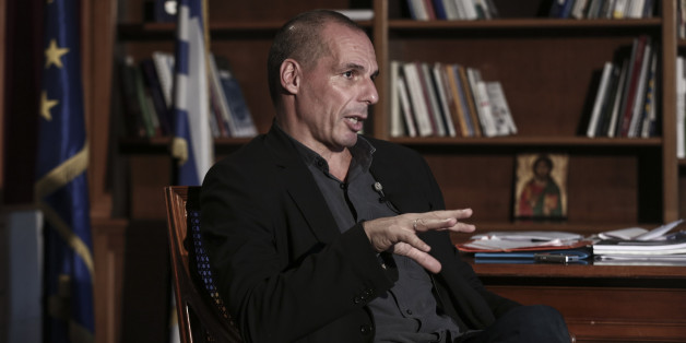 Yanis Varoufakis, Greece's finance minister, speaks during a Bloomberg Television interview at his office in Athens, Greece, on Wednesday, Feb. 25, 2015. Varoufakis said he's counting on the European Central Bank to help the country avert default when it runs out of money next month, while bank deposits are also starting to flow back. Photographer: Yorgos Karahalis/Bloomberg via Getty Images