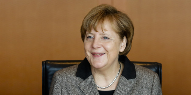 German Chancellor Angela Merkel smiles as she leads the weekly cabinet meeting of her government at the chancellery in Berlin, Germany, Wednesday, Feb. 25, 2015.  (AP Photo/Markus Schreiber)