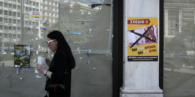A woman passes outside a closed shop as a poster reads in Greek '' yes to work, no to the euro''  in Athens, Wednesday, April 10, 2013.  The European Union's statistics agency, Eurostat, on Wednesday said that labor costs had sunk 11.2 percent in recession-hit Greece between 2008 and 2012, compared to the eurozone average increase of 8.7 percent. (AP Photo/Petros Giannakouris)