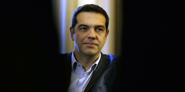 Greece's Prime Minister Alexis Tsipras listens to Greek President Karolos Papoulias during their meeting at Presidential Palace in Athens, Wednesday, Feb. 18, 2015. Greece was preparing Wednesday to present its creditors with an official proposal aimed to save bailout talks from collapse, as time is running out for a deal that would keep the country solvent and within the euro currency bloc. Germany, the main European creditor, was quick to say it was skeptical of any new proposals. (AP Photo/Thanassis Stavrakis)