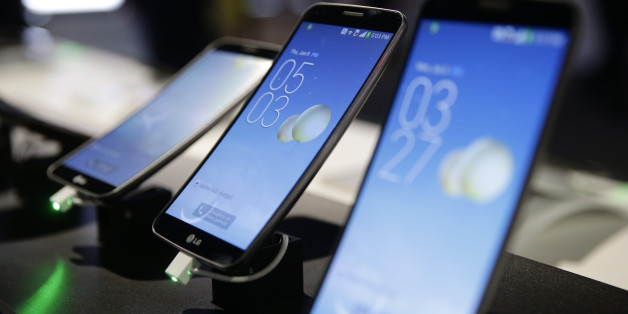 LG's G Flex smartphones are displayed at the International Consumer Electronics Show(CES) on Thursday, Jan. 9, 2014, in Las Vegas. (AP Photo/Jae C. Hong)