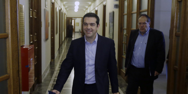 Greece's Prime Minister Alexis Tsipras arrives for an inner meeting at the parliament in Athens on Tuesday, Feb. 24, 2015. Caught between its campaign pledges and pressure from creditors, Greece's left-wing Syriza government delivered the list on the cusp of Monday night's deadline. The government was asked to present a list last Friday at a meeting of the 19 finance ministers of the eurozone so its bailout request could be met. (AP Photo/Thanassis Stavrakis)