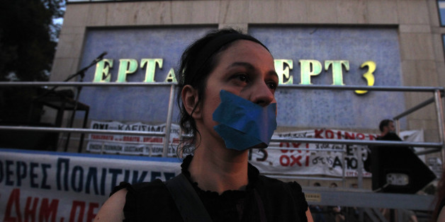 A protester with her mouth tapped takes part in a protest in solidarity to the employees of Greek state broadcaster ERT, in Thessaloniki Greece, on Friday, June 21, 2013. Greece's fragile coalition government was left bruised but standing after a junior party decided to pull its two ministers from the cabinet following a falling-out over the unpopular closure of state broadcaster ERT. Democratic Left pulled out of Prime Minister Antonis Samaras' year-old coalition, withdrawing two cabinet minist