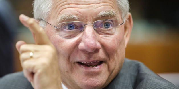 German Finance Minister Wolfgang Schauble smiles as he arrives for a EU finance ministers meeting at the European Council building in Brussels, Tuesday, July 8, 2014. (AP Photo/Geert Vanden Wijngaert)