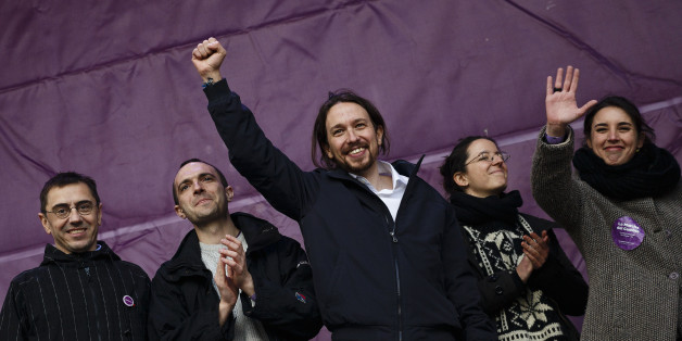"""Pablo Iglesias, center, leader of Spanish Podemos (We Can) left-wing party, raises his fist on the stage before giving a speech to his supporters gathering at the main square of Madrid during a Podemos (We Can) party march in Madrid, Spain, Saturday, Jan. 31, 2015. Tens of thousands of people, possibly more, are marching through Madrid's streets in a powerful show of strength by Spain's fledgling radical leftist party Podemos (We Can) which hopes to emulate the electoral success of Greece's Syriza party in elections later this year. Supporters from across Spain converged onto Cibeles fountain before packing the avenue leading to Puerta del Sol square. Podemos aims to shatter the country's predominantly two-party system and the """"March for Change"""" gathered crowds in the same place where sit-in protests against political and financial corruption laid the party's foundations in 2011. (AP Photo/Daniel Ochoa de Olza)"""
