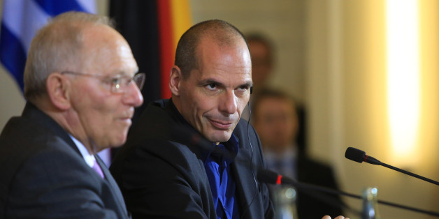 Yanis Varoufakis, Greece's finance minister, right, sits beside Wolfgang Schaeuble, Germany's finance minister, during a news conference at the Chancellery in Berlin, Germany, on Thursday, Feb. 5, 2015.  The meeting comes hours after Greece lost a critical funding artery when the European Central Bank restricted loans to its financial system. Photographer: Krisztian Bocsi/Bloomberg via Getty Images
