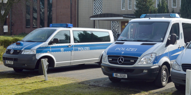 "Police cars stand in front of the synagogue in Bremen, Germany, Saturday Feb. 28, 2015. Police in the German city of Bremen are warning of a potential danger from Islamic extremists there and say they are stepping up security measures. A police statement said that officials received tips about activities of potentially dangerous Islamic extremists from a German federal authority on Friday evening. Saturday's statement said that police in the northwestern city are responding ""with coordinated and adapted security measures."" (AP Photo/dpa, Carmen Jaspersen)"