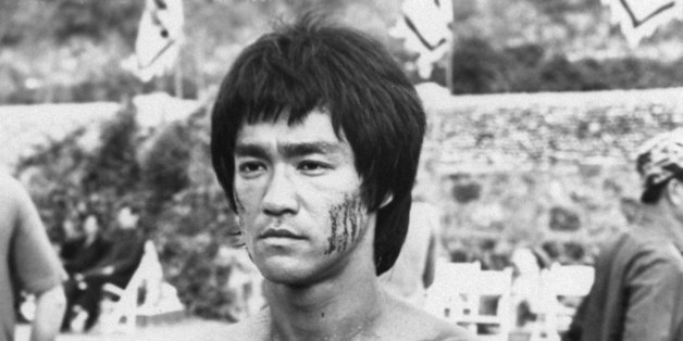 "Bruce Lee is shown in a scene from the 1973 film, ""Enter the Dragon,"" completed shortly before the martial arts stars' death of brain edema in 1973. (AP Photo/HO)"