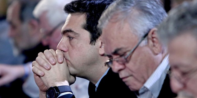 Greek Prime Minister Alexis Tsipras (L) sists next to Deputy Prime Minister Giannis Dragasakis (R) before delivering a  speech at the Syriza party headquarters, in Athens on February 28, 2015. Greece's Prime minister vowed Saturday no retreat from his principles in the eurozone country's 'battle' with creditors as he seeks to live up to election promises to reverse austerity cuts and avoid a third bailout. 'The battle will continue,' the far-left Alexis Tsipras told the central committee of his hard-left Syriza party in Athens. 'Anybody thinking that we are going to go away will be disappointed.' AFP PHOTO / Angelos Tzortzinis        (Photo credit should read ANGELOS TZORTZINIS/AFP/Getty Images)