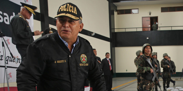 FILE - In this Sept. 1, 2014 file photo, Peru's Interior Minister Daniel Urresti talks with the press during the presentation of seized drugs at a police base in Lima, Peru. Urresti, a former army general, has been charged with murdering a journalist during the country's conflicts 26 years ago, prosecutor Luis Landa announced. Landa said in interviews published Sunday, March 1, 2105 by three newspapers that he is seeking a 25-year prison term for Urresti based on evidence that, as local army int