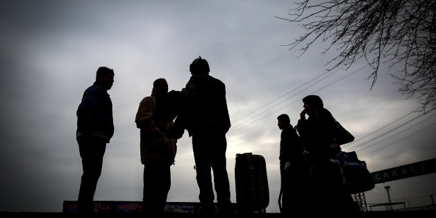 People are seen at the Akcakale border gate in Turkey, Saturday, Jan. 31, 2015, as some others wait for the possible release of Japanese journalist Kenji Goto, kidnapped by the Islamist militant group in Syria. The fates of a Japanese journalist and Jordanian military pilot were unknown Friday, a day after the latest purported deadline for a possible prisoner swap passed with no further word from the Islamic State group holding them captive.(AP Photo/Emrah Gurel)