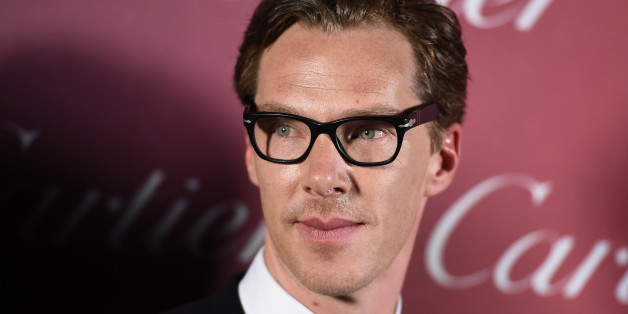 """Benedict Cumberbatch, of """"The Imitation Game"""", poses in the press room after winning the ensemble performance award at the 26th annual Palm Springs International Film Festival Awards Gala on Saturday, Jan. 3, 2015, in Palm Springs, Calif. (Photo by Jordan Strauss/Invision/AP)"""