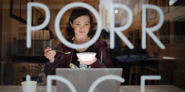 Holly Mac eats a bowl of porridge at the 'Porridge Cafe' in Shoreditch on March 2, 2015 in London, England.