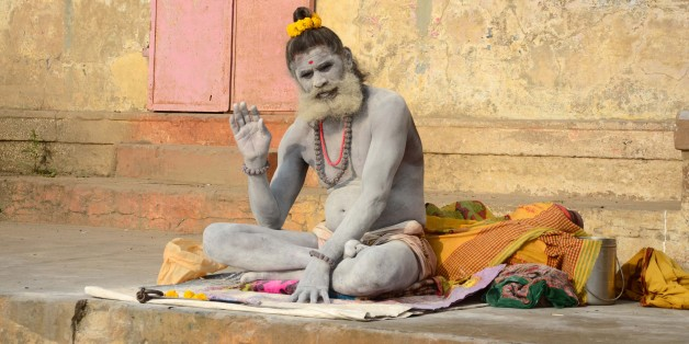 VARANASI, INDIA - 2015/02/21: A sadhu performing morning ritual at Dashaswamegh Ghat bank of River Ganges. (Photo by Prabhat Kumar Verma/Pacific Press/LightRocket via Getty Images)