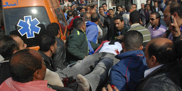 A wounded man is evacuated from the site of an explosion in a crowded area near the Egyptian High Court, in downtown Cairo, Egypt, Monday, March 2, 2015. Egyptian state TV says a midday bomb blast in downtown Cairo wounded several people. Egypt has seen a series of attacks mainly targeting security forces since the military ousted Islamist President Mohammed Morsi in the summer of 2013. The attacks have raised fears ahead of an economic conference later this month aimed at attracting foreign inv