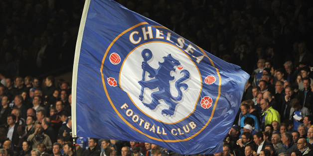 Chelsea fans with a giant flag in the stands