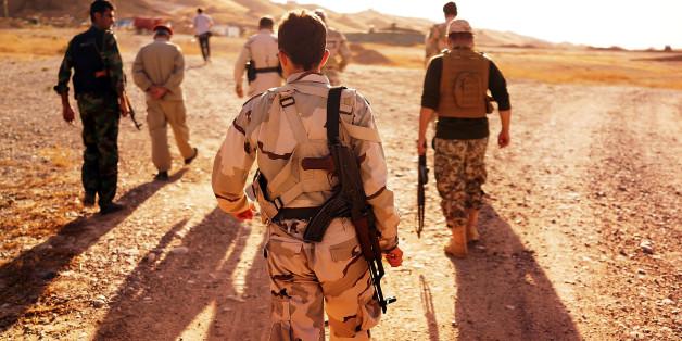 Die Religion auf den Arm tätowiert - Christen fliehen derzeit vor ISIS im irak
