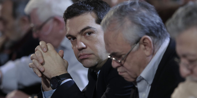 Greek Prime Minister and Syriza leader Alexis Tsipras, third right, looks on at his party central committee, in Athens, on Saturday, Feb. 28, 2015. Greece's new radical left government has no intention of seeking yet another bailout deal from international creditors and will spend coming months trying to ease the terms of its current commitments, the financially struggling country's prime minister said Friday. (AP Photo/Petros Giannakouris)