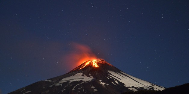 Picture of the Villarrica volcano, located near Villarrica 1200 km from Santiago, in southern Chile, which began erupting on March 3, 2015 forcing the evacuation of some 3,000 people in nearby villages. The Villarrica volcano, one of Chile's most active, began erupting around 3:00 am (0600 GMT), prompting authorities to declare a red alert and cancel classes in schools, the National Emergency Office said.   AFP PHOTO /ARIEL MARINKOVIC        (Photo credit should read ARIEL MARINKOVIC/AFP/Getty I