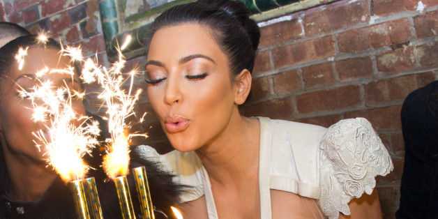 Kim Kardashian blows out the candles on a cake in celebration of her 30th Birthday at the 10th Anniversary of TAO restaurant in New York, early Sunday, Oct. 17, 2010. (AP Photo/Charles Sykes)