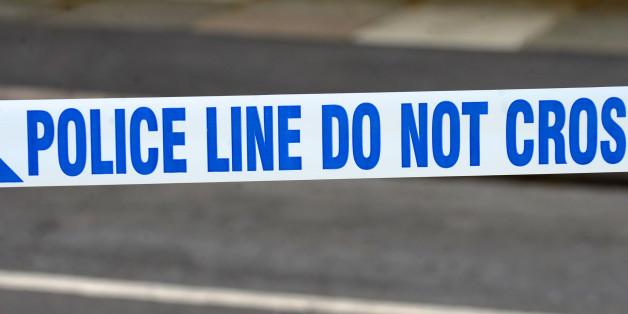 A generic stock photo of police tape outside a murder scene in Wallasey, Merseyside.