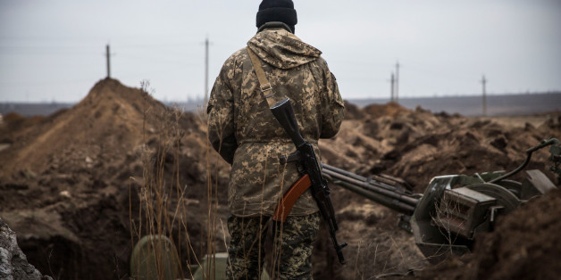 BERDIANSKE, UKRAINE - FEBRUARY 28:  A Ukrainian soldier stands next to newly dug trenches near the front line of defense against pro-Russian seperatists on February 28, 2015 near in the village of Berdianske, Ukraine. Berdianske is on the eastern side of Mariupol, Ukraine - many Ukrainian soldiers believe pro-Russian seperatists will try to take control of the city of Mariupol next in an effort to create a land bridge between Russia and Crimea.  (Photo by Andrew Burton/Getty Images)