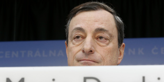 FILE - In this Feb. 6, 2014 file photo, President of European Central Bank Mario Draghi speaks during a press conference following the meeting of the governing council in Frankfurt, Germany. An adviser to the European Court of Justice says the European Central Bank's offer to purchase government bonds of troubled countries, a key backstop in Europe's struggle against its debt crisis, is compatible in principle with the basic EU treaty. (AP Photo/Michael Probst, File)