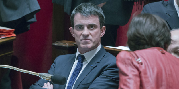 French prime  minister Manuel Vals attends  a session of the French National Assembly in Paris, Tuesday, Feb. 17, 2015. France's Parliament votes on a hotly debated and potentially landmark bill that loosens up some labor rules to boost hiring and notably allows stores to open Sundays and evenings for tourists. Leftists and labor unions say the bill is too pro-business, but the Socialist government says it's time to face modern economic realities. (AP Photo/Jacques Brinon)
