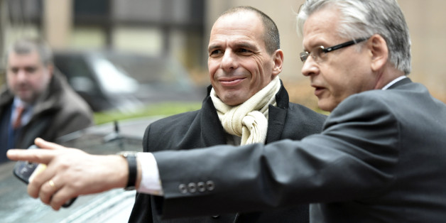 Greek Finance Minister Yanis Varoufakis, center, arrives for a meeting of eurogroup finance ministers in Brussels on Friday, Feb. 20, 2015. Eurozone finance ministers meet for a crucial day of talks Friday to see whether a Greek debt relief proposal is acceptable to Germany and other nations using the common currency. (AP Photo/Geert Vanden Wijngaert)