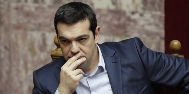 Greece's Prime Minister Alexis Tsipras gestures during a Presidential vote in Athens, on Wednesday, Feb. 18, 2015. Greece's parliament elected a conservative law professor and veteran politician Wednesday as the country's new president, after he received support from the new left-wing government and main center-right opposition party. (AP Photo/Petros Giannakouris)
