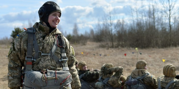A Ukrainian paratrooper shares a laugh with comrades during military drills in the Zhytomyr region, some 150 kms from Kiev, on March 6, 2015. Western powers said new sanctions against Moscow could quickly follow any foul play in the ceasefire in eastern Ukraine, where Kiev reported pulling back more hardware from the frontline. AFP PHOTO / GENYA SVILOV        (Photo credit should read GENYA SAVILOV/AFP/Getty Images)