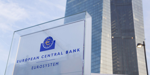A sign sits outside the new headquarters of the European Central Bank (ECB) in Frankfurt, Germany, on Friday, Feb. 13, 2015. The ECB's plan to buy at least 1.1 trillion euros of bonds to boost inflation across the currency union is shielding the bloc's other debtor nations during the latest phase of the Greek crisis. Photographer: Martin Leissl/Bloomberg via Getty Images