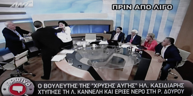 In this image taken off a TV screen, Ilias Kasidiaris, 2nd left, spokesman of Greece's extremist far-right Golden Dawn party, who was elected to Parliament in the country's recent inconclusive polls physically assaults Liana Kanelli, a female member of the Parliament for the Greek Communist party during a talk show at the studios of the ANTENA TV station in Athens on Thursday, June 7, 2012. Kasidiaris bounded out of his seat and slapped Communist Party member Liana Kanelli three times on Thursda