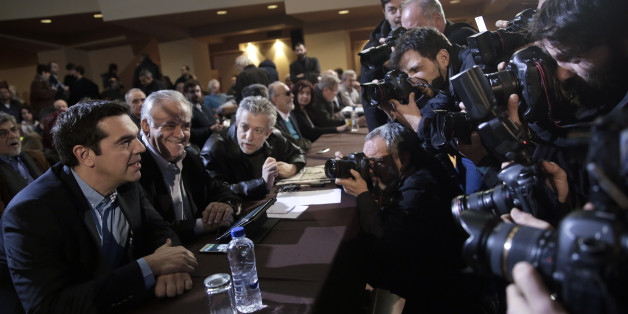 Greek Prime Minister and Syriza leader Alexis Tsipras, left, attends his party central committee, in Athens, on Saturday, Feb. 28, 2015. Greece's new radical left government has no intention of seeking yet another bailout deal from international creditors and will spend coming months trying to ease the terms of its current commitments, the financially struggling country's prime minister said Friday.(AP Photo/Petros Giannakouris)