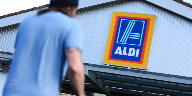 A customer pushes a shopping cart towards the entrance of an Aldi discount supermarket, operated by Aldi Stores Ltd., in Chelmsford, U.K., on Tuesday, Oct. 7, 2014. Wm Morrison Supermarkets Plc stepped up the battle for U.K. supermarket customers by becoming the first of Britain's four biggest grocers to match its prices to those of discounters Aldi and Lidl Ltd. Photographer: Chris Ratcliffe/Bloomberg via Getty Images
