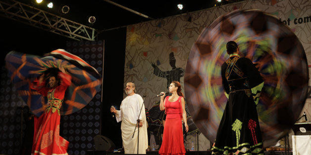 In this Friday, Feb. 6, 2015 photo, Egyptian singer Amer Eltony, in white robe, Moroccan singer Karen Ruimy and artists of Egyptian Mawlawiyahh group perform during Sufi Sutra, an international festival of Sufi and traditional music, in Kolkata, India. Besides Indian states of Rajasthan, Gujarat and West Bengal, international participants from Brazil, Denmark, Egypt, Morocco, Tunisia and Spain are also present in this three-day event. (AP Photo/Bikas Das)